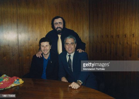 Italian presenter Fabio Fazio Italian comedian and actor Teo Teocoli and Italian tenor Luciano Pavarotti are the presenters of the 50th Sanremo Music...