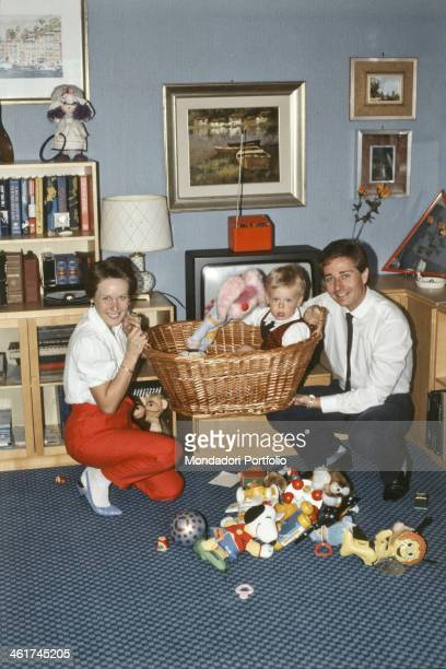 Italian presenter Paolo Bonolis and his wife American psychologist Diane Zoeller holding their son Stefano in a basket with the puppet Uan in his...