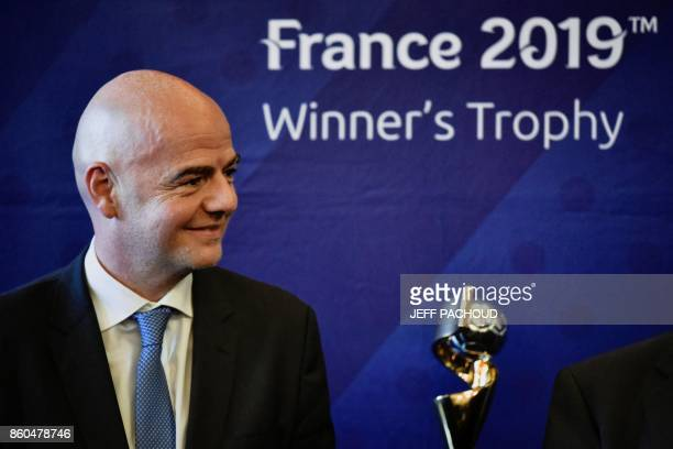 FIFA Italian president Gianni Infantino poses next to the trophy during a press conference to present the FIFA Women's World Cup France 2019 at the...