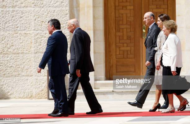 Italian President Giorgio Napolitano and his wife Clio Napolitano are welcomed by Jordan's King Abdullah II and Queen Rania of Jordan during an...
