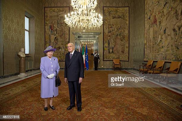 Italian President Giorgio Napolitano greets Her Majesty Queen Elizabeth II in the 'Sala del Bronzino' of the 'Palazzo del Quirinale' during her...
