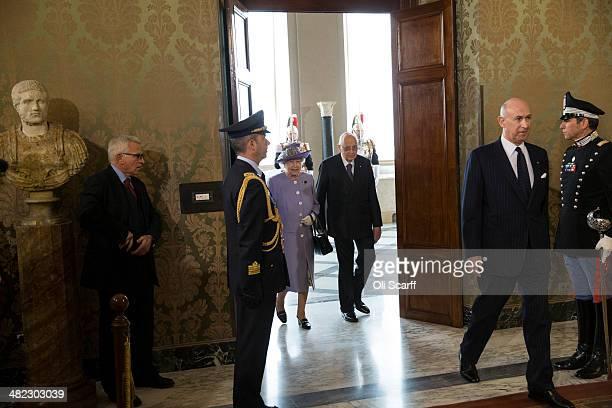 Italian President Giorgio Napolitano greets Her Majesty Queen Elizabeth II in the 'Sala del Bronzino' of the 'Palazzo del Quirinale' during their...