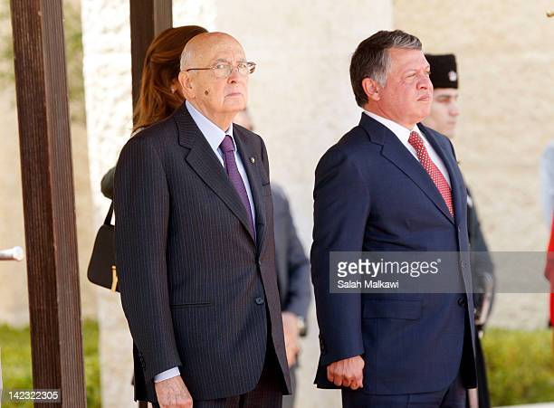 Italian President Giorgio Napolitano reviews the Jordanian royal honor guard during his reception by Jordan's King Abdullah II prior to an official...