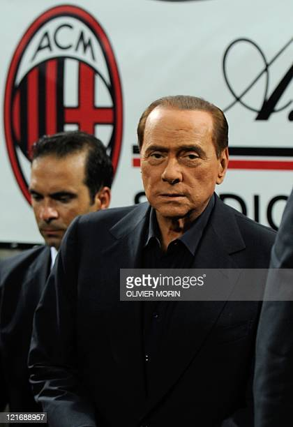 Italian President of Council Silvio Berlusconi steps on the pitch after AC MIlan won the Trophee Luigi Berlusconi match AC Milan against Juventus 21...