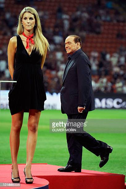 Italian President of Council Silvio Berlusconi steps on the podium after AC Milan wion the Trophee Luigi Berlusconi match AC Milan against Juventus...