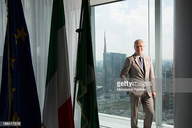Italian President of Lombardy Roberto Formigoni posing at Palazzo Lombardia in front of the Unicredit Tower Milan 13th June 2012