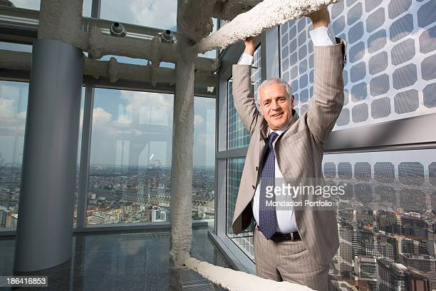 Italian President of Lombardy Roberto Formigoni posing leaning against a beam at Palazzo Lombardia Milan 13th June 2012