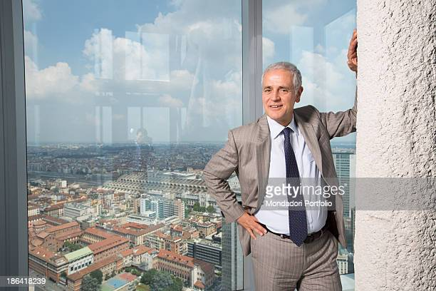 Italian President of Lombardy Roberto Formigoni posing leaning against a column at Palazzo Lombardia Milan 13th June 2012