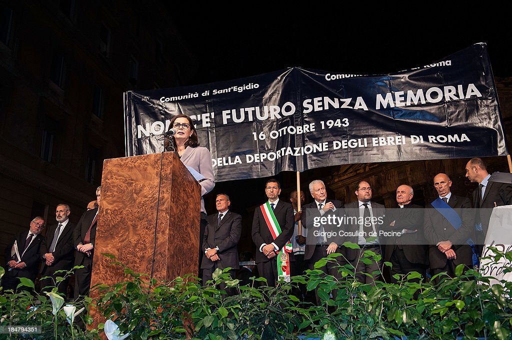 Italian President of the Chambers of Duputy, Laura Boldrini, gives a speech during the commemoration of the 70th anniversary of the deportation of Roman Jews on October 16, 2013 in Rome, Italy. On October 16, 1943, Nazi troops invaded the streets of Portico d'Ottavia, in the Jewish ghettos of Rome, and took 1,024 people, including more than 200 children, who were later destined for the concentration camps of Auschwitz. Only fifteen men and one woman returned home from Poland.