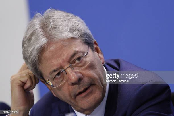 Italian President Paolo Gentiloni attends a Press conference after a meeting of European Union leaders at the Chancellery on June 29 2017 in Berlin...