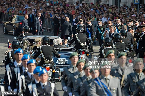 Italian President Sergio Mattarella waves to people as he rides in a car in central Rome on June 2 during celebrations marking Italy's Republic Day...