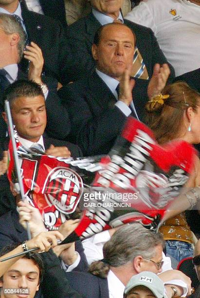 Italian Prime Minister and AC Milan president Silvio Berlusconi watches his team play against Brescia during their Italian Serie A football match at...