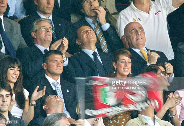 Italian Prime Minister and AC Milan's president Silvio Berlusconi watches his team playing against Brescia during their Italian Serie A football...