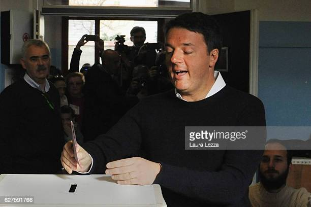 Italian Prime Minister and Democratic Party leader Matteo Renzi casts his vote for the constitutional referendum on December 4 2016 in in Pontassieve...