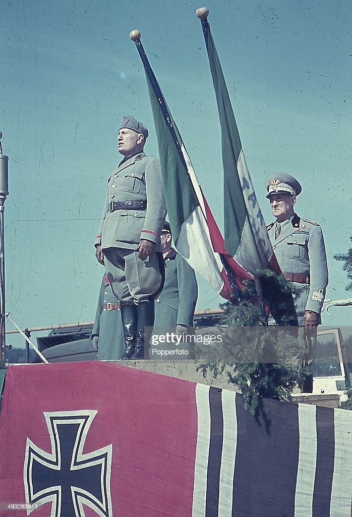 Italian Prime Minister <a gi-track='captionPersonalityLinkClicked' href=/galleries/search?phrase=Benito+Mussolini&family=editorial&specificpeople=90389 ng-click='$event.stopPropagation()'>Benito Mussolini</a> (1883-1945) addresses Italian troops sent to assist German Forces during Operation Barbarossa, the Axis invasion of the Soviet Union in August 1941. Italian Army commander Rodolfo Graziani (1882-1955) stands behind Mussolini on the podium.