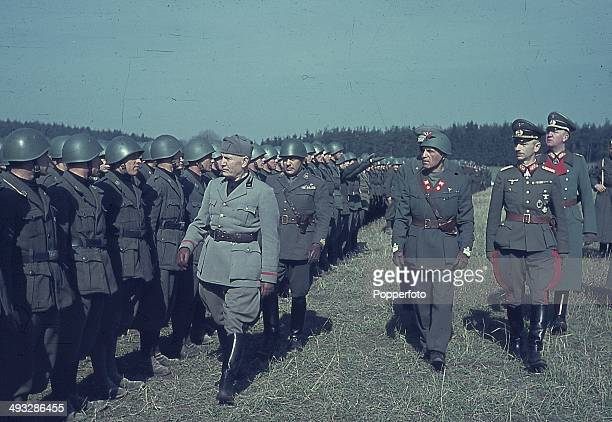 Italian Prime Minister Benito Mussolini reviews his troops sent to assist German forces in the invasion of the Soviet Union code named Operation...