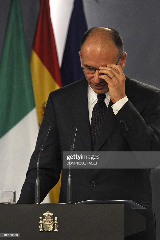 Italian Prime Minister Enrico Letta adjusts his glasses during a press conference after a meeting with Spain's Prime Minister Mariano Rajoy at the Moncloa Palace in Madrid on May 6, 2013. Letta is visiting Spain as part of a tour of European capitals that has already taken him to Berlin, Brussels and Paris.