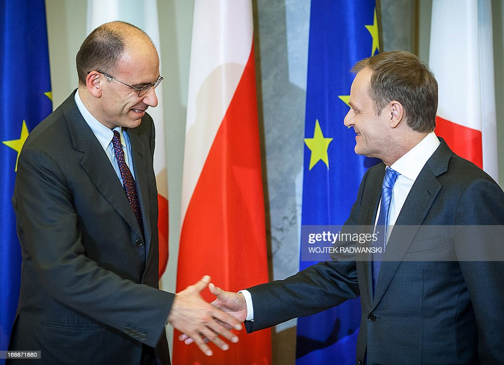 Italian Prime minister Enrico Letta (L) and his Polish counterpart Donald Tusk shake hands ahead of a meeting in Warsaw,on May 16, 2013.