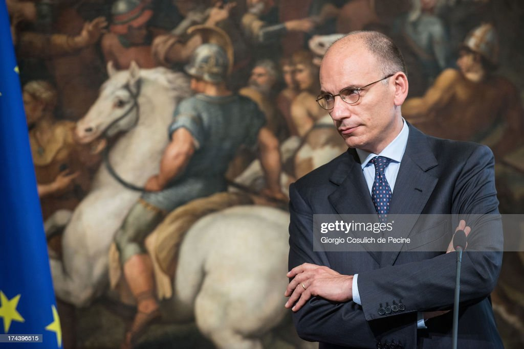 Italian Prime Minister <a gi-track='captionPersonalityLinkClicked' href=/galleries/search?phrase=Enrico+Letta&family=editorial&specificpeople=2915592 ng-click='$event.stopPropagation()'>Enrico Letta</a> attends a press conference with Secretary General of NATO Anders Fogh Rasmussen (not in picture) at Palazzo Chigi on July 25, 2013 in Rome, Italy. During the press conference the Prime Minister <a gi-track='captionPersonalityLinkClicked' href=/galleries/search?phrase=Enrico+Letta&family=editorial&specificpeople=2915592 ng-click='$event.stopPropagation()'>Enrico Letta</a> announced that he will travel to Afghanistan on August 12 to visit the Italian troops.