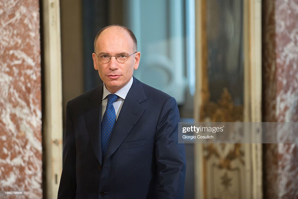 Italian Prime Minister <a gi-track='captionPersonalityLinkClicked' href=/galleries/search?phrase=Enrico+Letta&family=editorial&specificpeople=2915592 ng-click='$event.stopPropagation()'>Enrico Letta</a> awaits the arrival of Nobel Peace Laureate Aung San Suu Kyi (not in picture) for a meeting at Palazzo Chigi on October 28, 2013 in Rome, Italy. Aung San Suu Kyi was awarded the honorary citizenship in 1994 but had been prevented from receiving it after being kept under house arrest until November 13, 2010 , by Burma's military junta.