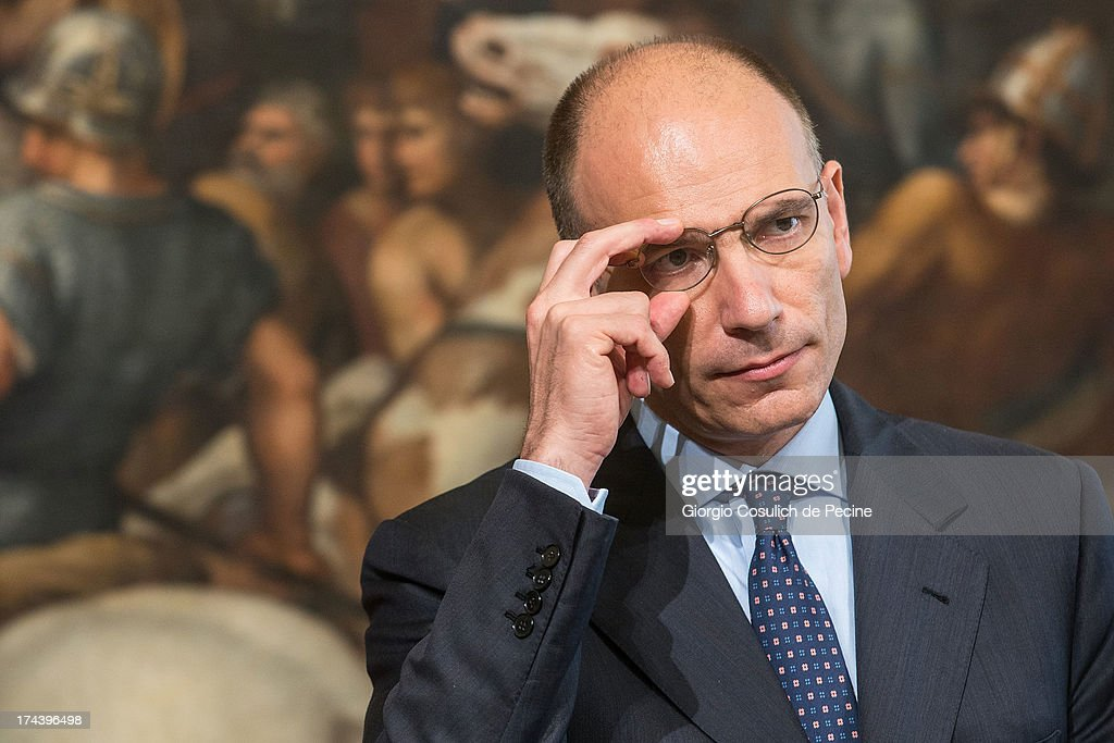 Italian Prime Minister <a gi-track='captionPersonalityLinkClicked' href=/galleries/search?phrase=Enrico+Letta&family=editorial&specificpeople=2915592 ng-click='$event.stopPropagation()'>Enrico Letta</a> gestures as he attends a press conference with Secretary General of NATO Anders Fogh Rasmussen (not in picture) at Palazzo Chigi on July 25, 2013 in Rome, Italy. During the press conference the Prime Minister <a gi-track='captionPersonalityLinkClicked' href=/galleries/search?phrase=Enrico+Letta&family=editorial&specificpeople=2915592 ng-click='$event.stopPropagation()'>Enrico Letta</a> announced that he will travel to Afghanistan on August 12 to visit the Italian troops.