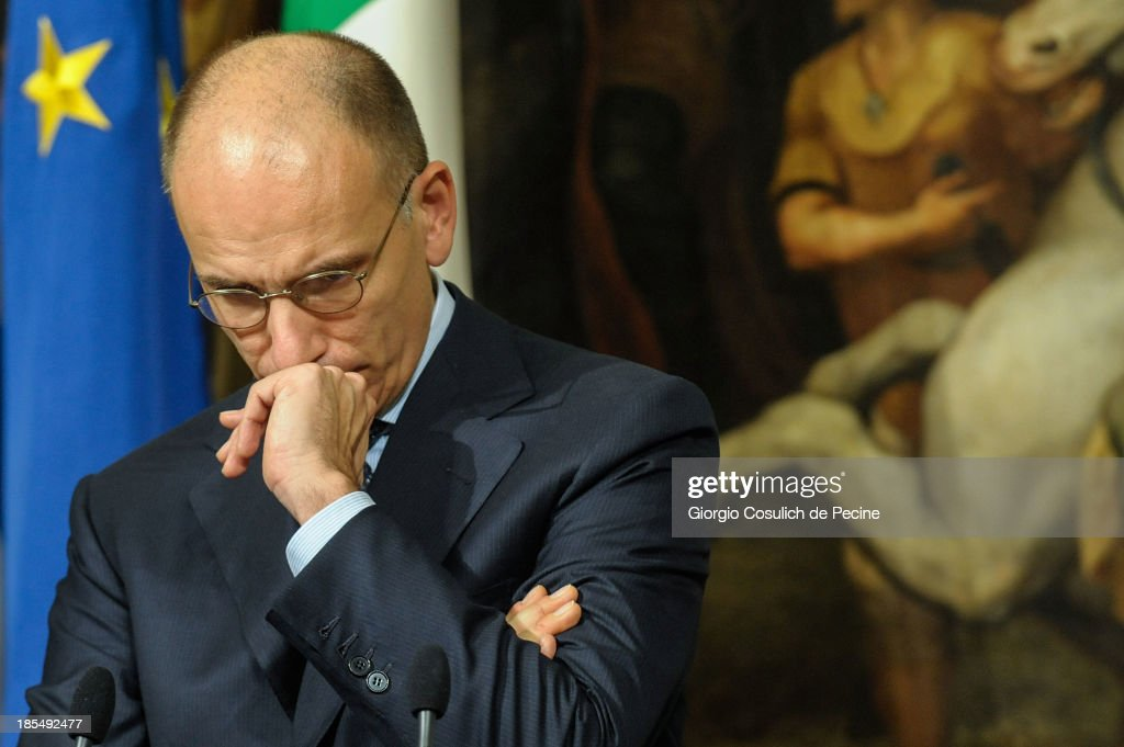 Italian Prime Minister <a gi-track='captionPersonalityLinkClicked' href=/galleries/search?phrase=Enrico+Letta&family=editorial&specificpeople=2915592 ng-click='$event.stopPropagation()'>Enrico Letta</a> gestures as he attends a press conference after a meeting with Greek Prime Minister Antonis Samaras at Palazzo Chigi on October 21, 2013 in Rome, Italy. During the meeting, the two Prime Ministers talked about immigration policy and European banking union.