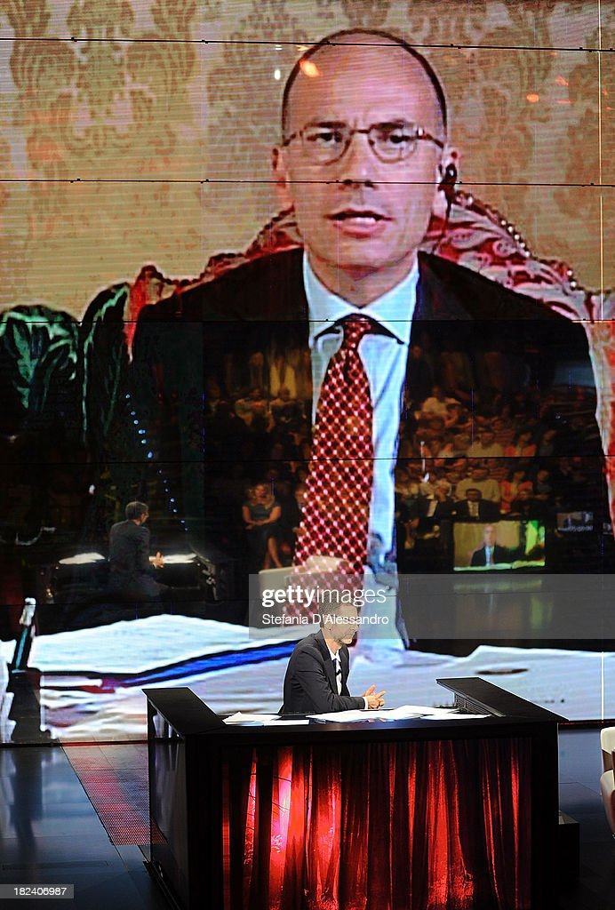 Italian Prime Minister Enrico Letta is seen live on a screen during 'Che Tempo Che Fa' TV Show on September 29, 2013 in Milan, Italy.