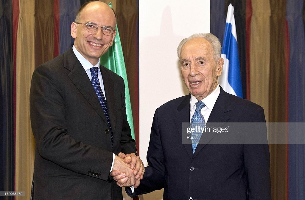 Italian Prime Minister Enrico Letta (L) shakes hands with Israeli President Shimon Peres (R) during a diplomatic working meeting July 01, 2013 in Tel Aviv, Israel. The two leaders reportedly talked about peace talks between the Israeli's and Palestinians and the Iranian nuclear weapons program.