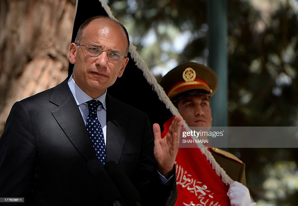 Italian Prime Minister Enrico Letta speaks during a joint press conference with Afghan President Hamid Karzai at the Presidential palace in Kabul on August 25, 2013. Letta visited the base of the Italian contingent in Herat on his arrival in the country - Italy has around 3,000 soldiers in Afghanistan as part of NATO's International Security Assistance Force (ISAF). AFP PHOTO/ SHAH Marai