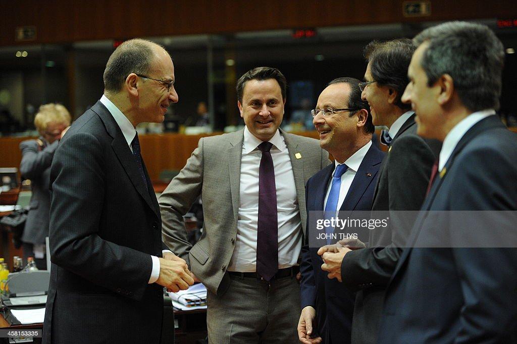 Italian Prime Minister Enrico Letta talks to Luxembourg Prime Minister Xavier Bettel French President Francois Hollande Belgian Prime Minister Elio...