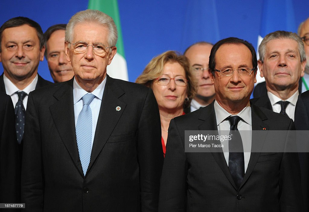 Italian Prime Minister <a gi-track='captionPersonalityLinkClicked' href=/galleries/search?phrase=Mario+Monti&family=editorial&specificpeople=632091 ng-click='$event.stopPropagation()'>Mario Monti</a> and French President Francois Hollande pose during the family photo at the French Italian Summit on December 3, 2012 in Lyon, France. The two countries are meeting to sign an official accord for the construction of new high speed (TAV) rail line running from Lyon to Torino.