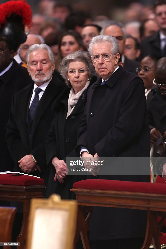 Italian Prime minister <a gi-track='captionPersonalityLinkClicked' href=/galleries/search?phrase=Mario+Monti&family=editorial&specificpeople=632091 ng-click='$event.stopPropagation()'>Mario Monti</a> (R) and his wife Elsa attend the Epiphany Mass at the St. Peter's Basilica held by Pope Benedict XVI on January 6, 2013 in Vatican City, Vatican. During the ceremony the pontiff named four new bishops including his personal secretary Georg Gaenswein.