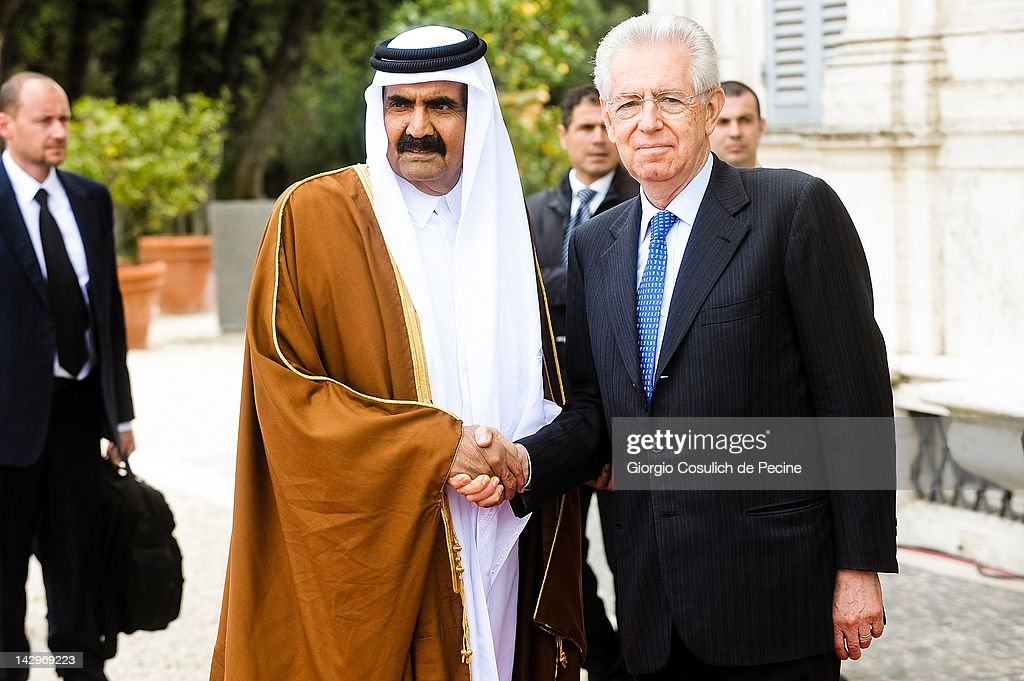 Italian Prime Minister <a gi-track='captionPersonalityLinkClicked' href=/galleries/search?phrase=Mario+Monti&family=editorial&specificpeople=632091 ng-click='$event.stopPropagation()'>Mario Monti</a> (R) and Qatari Emir Sheikh Hamad bin Khalifa al-Thani shake hands as they arrive for a bilateral summit at Villa Pamphilj on April 16, 2012 in Rome, Italy. The meeting between the two leaders aims to redefine the commercial relations between Qatar and Italy. The emirate is among the top three global producers of natural gas and Italy imports 10% of it's national demand for gas from the Persian Gulf.