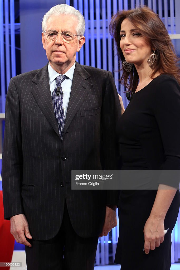 Italian Prime Minister Mario Monti (R) and tv conductor Tiziana Panella (L) attend 'Coffee Break' TV show at La7 studios on February 4, 2013 in Rome, Italy. Outgoing Italian prime minister Mario Monti will lead a centrist alliance during the Italian elections scheduled for February 24.