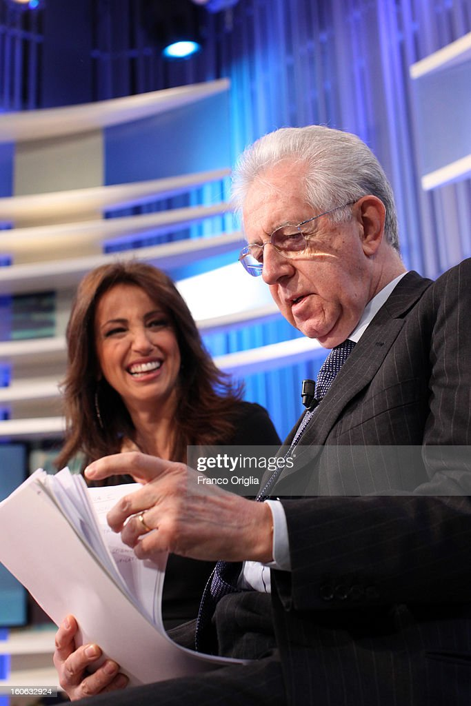 Italian Prime Minister <a gi-track='captionPersonalityLinkClicked' href=/galleries/search?phrase=Mario+Monti&family=editorial&specificpeople=632091 ng-click='$event.stopPropagation()'>Mario Monti</a> (R) and tv conductor Tiziana Panella (L) attend 'Coffee Break' TV show at La7 studios on February 4, 2013 in Rome, Italy. Outgoing Italian prime minister <a gi-track='captionPersonalityLinkClicked' href=/galleries/search?phrase=Mario+Monti&family=editorial&specificpeople=632091 ng-click='$event.stopPropagation()'>Mario Monti</a> will lead a centrist alliance during the Italian elections scheduled for February 24.