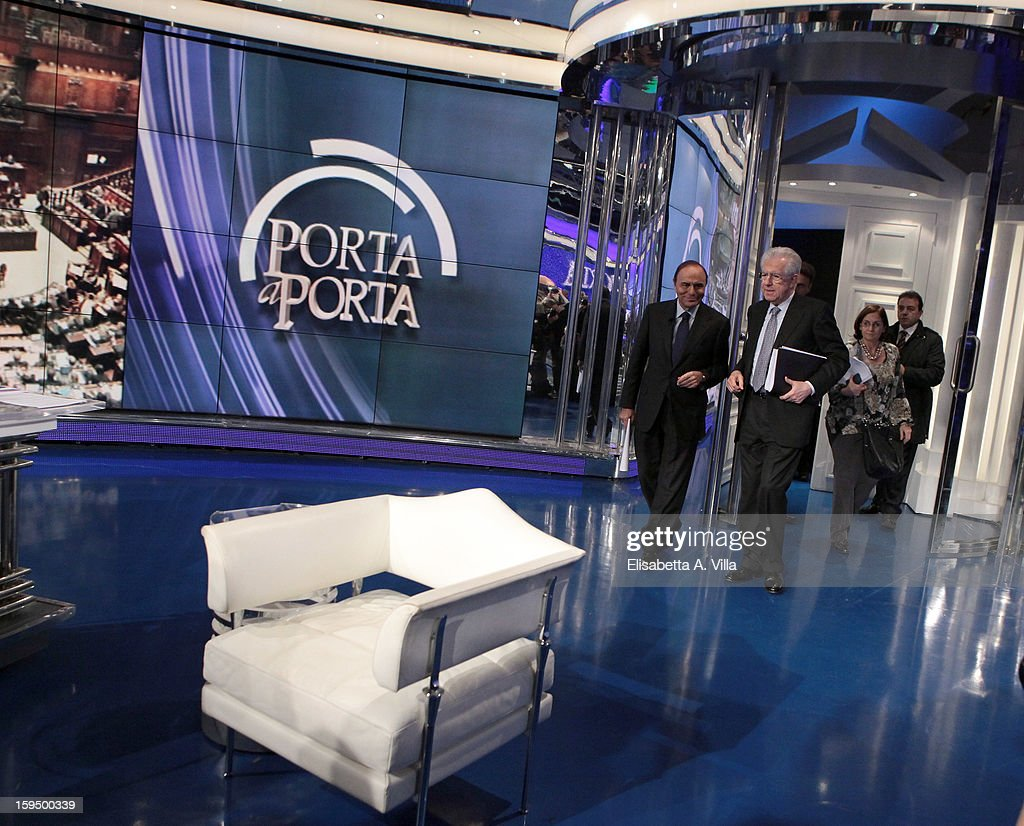 Italian Prime Minister Mario Monti (C) and TV host Bruno Vespa (L) attend 'Porta A Porta' Italian TV Show on January 14, 2013 in Rome, Italy.