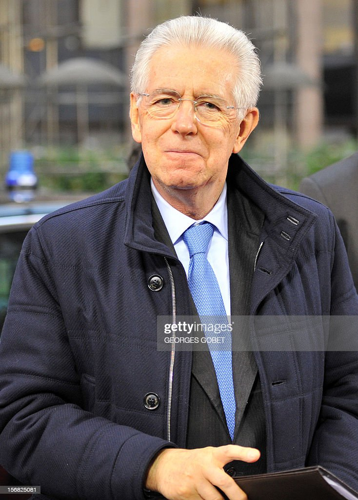 Italian Prime Minister Mario Monti arrives at the EU Headquarters on November 22, 2012 in Brussels, to take part in a two-day European Union leaders summit called to agree a hotly-contested trillion-euro budget through 2020. European Union officials were scrambling to find an all but impossible compromise on the 2014-2020 budget that could successfully move richer nations looking for cutbacks closer to poorer ones who look to Brussels to prop up hard-hit industries and regions. AFP PHOTO / GEORGES GOBET