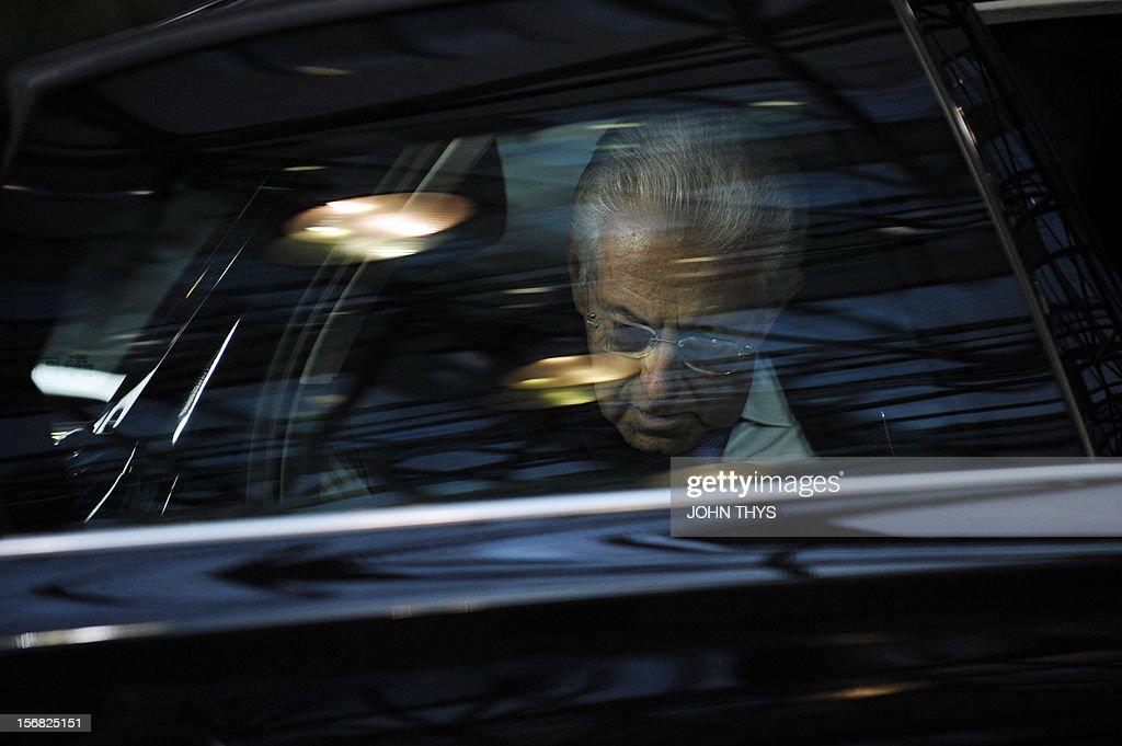 Italian Prime Minister Mario Monti arrives at the EU Headquarters on November 22, 2012 in Brussels, to take part in a two-day European Union leaders summit called to agree a hotly-contested trillion-euro budget through 2020. European Union officials were scrambling to find an all but impossible compromise on the 2014-2020 budget that could successfully move richer nations looking for cutbacks closer to poorer ones who look to Brussels to prop up hard-hit industries and regions.