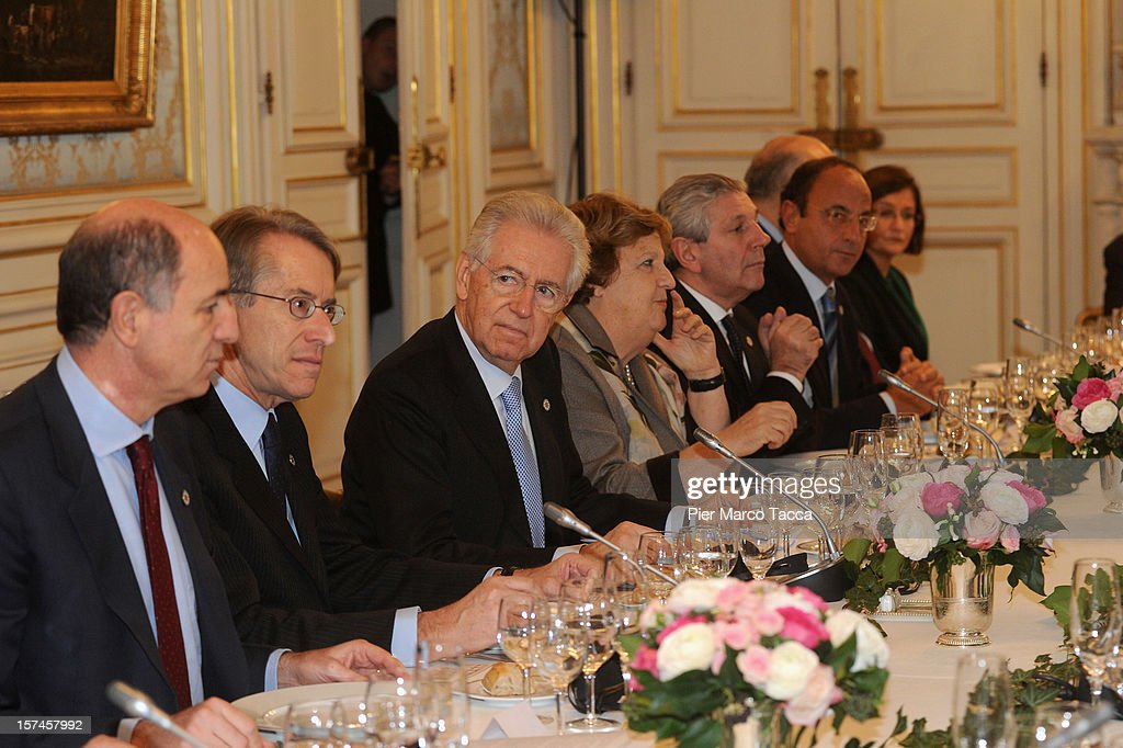 Italian Prime Minister <a gi-track='captionPersonalityLinkClicked' href=/galleries/search?phrase=Mario+Monti&family=editorial&specificpeople=632091 ng-click='$event.stopPropagation()'>Mario Monti</a> (C) attends a meeting for the French Italian Summit attend the French Italian Summit on December 3, 2012 in Lyon, France. The two countries are meeting to sign an official accord for the construction of new high speed (TAV) rail line running from Lyon to Torino.