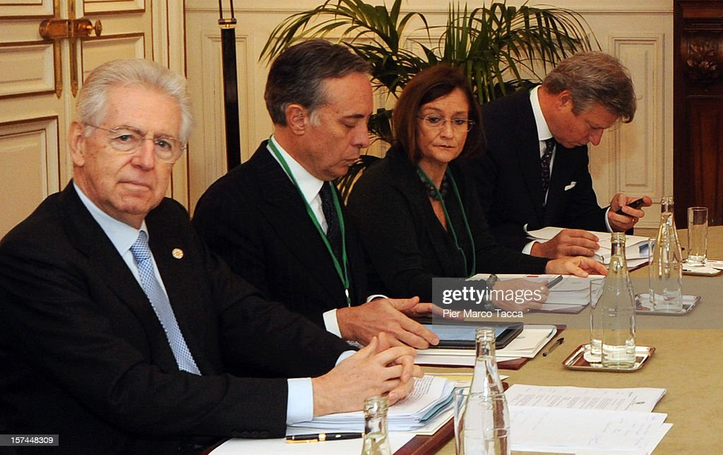 Italian Prime Minister <a gi-track='captionPersonalityLinkClicked' href=/galleries/search?phrase=Mario+Monti&family=editorial&specificpeople=632091 ng-click='$event.stopPropagation()'>Mario Monti</a> (L) attends the French Italian Summit at prefecture building on December 3, 2012 in Lyon, France. The official accord for the construction of new high speed (TAV) rail line, running from Lione to Torino, is due to be signed today at the bilateral meeting.