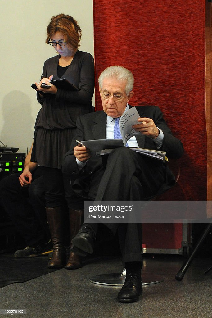 Italian Prime Minister <a gi-track='captionPersonalityLinkClicked' href=/galleries/search?phrase=Mario+Monti&family=editorial&specificpeople=632091 ng-click='$event.stopPropagation()'>Mario Monti</a> attends the presentation of Lombardy candidates of 'Scelta Civica con Monti per l'Italia' on February 2, 2013 in Milan, Italy. Monti used the rally to unveil the list of Lombardy candidates for the 'Civic Choice' (Scelta Civica) movement that will be running in February's parliamentary elections.