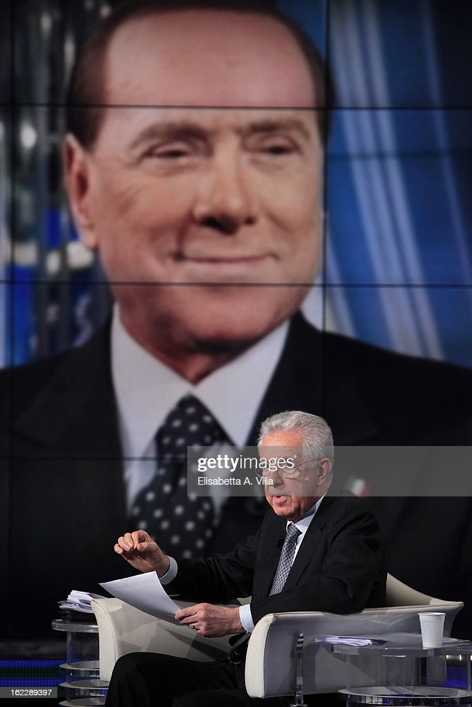 Italian Prime Minister Mario Monti during filming for the 'A Porta A Porta' TV Show while a portrait of Silvio Berlusconi is displayed on February 21, 2013 in Rome, Italy. Mario Monti, leader of a centrist alliance, is continuing his campaign for the upcoming general elections that take place on February 24th and 25th.