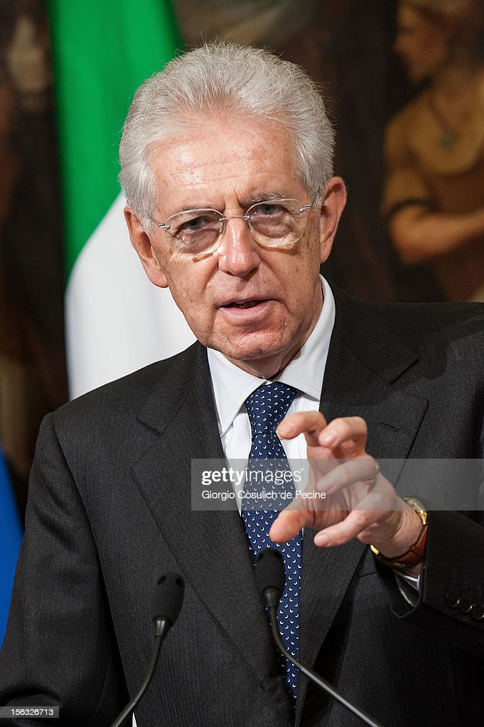Italian Prime Minister <a gi-track='captionPersonalityLinkClicked' href=/galleries/search?phrase=Mario+Monti&family=editorial&specificpeople=632091 ng-click='$event.stopPropagation()'>Mario Monti</a> gestures as he attends a press conference with British Prime Minister David Cameron at Palazzo Chigi on November 13, 2012 in Rome, Italy. During the press conference David Cameron said that the European Union needs a banking union and Britain stands ready to support the initiative to the extent that financial mechanisms are safeguarded.