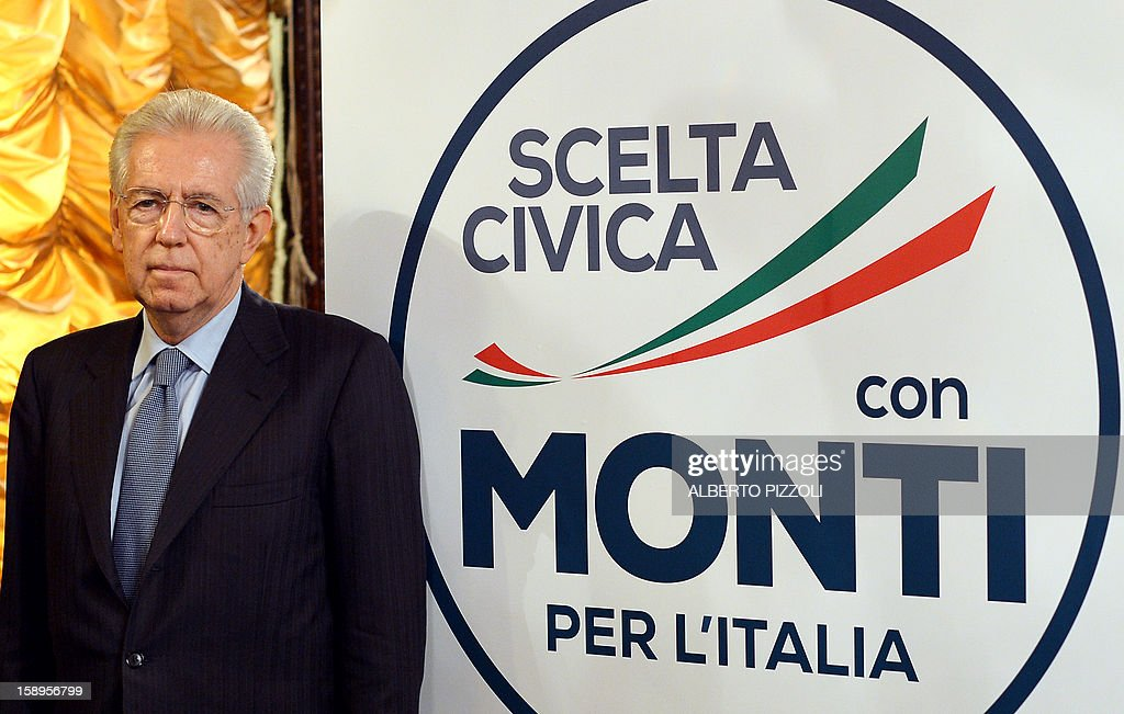 Italian Prime Minister Mario Monti poses next to the logo of his new party, during a news conference held in Rome on January 4, 2013. A coalition of centrist parties led by Italy's outgoing Prime Minister Mario Monti is currently running in fourth place ahead of early elections in February, according to a poll published on Friday.