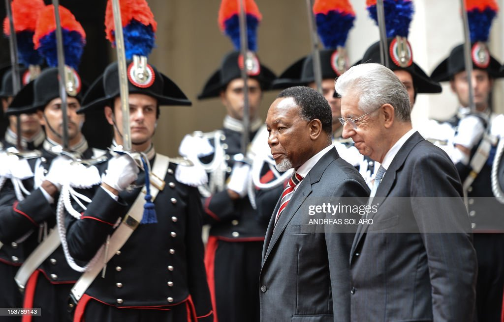 Italian Prime Minister Mario Monti (R) reviews an honour guard with South Africa's Vice-President Kgalema Motlanthe prior their meeting on October 9, 2012 at Palazzo Chigi, the Italian Prime Ministry in Rome.