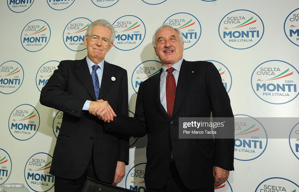 Italian Prime Minister <a gi-track='captionPersonalityLinkClicked' href=/galleries/search?phrase=Mario+Monti&family=editorial&specificpeople=632091 ng-click='$event.stopPropagation()'>Mario Monti</a> shakes hands Alberto Bombassei during a convention for his centrist alliance 'With Monti For Italy' (Con Monti Per L'Italia) at Kilometro Rosso on January 20, 2013 in Bergamo, Italy. Monti used the rally to unveil the list of candidates for the 'Civic Choice' (Scelta Civica) movement, a bloc that will form part of the centrist alliance running in February's parliamentary elections.
