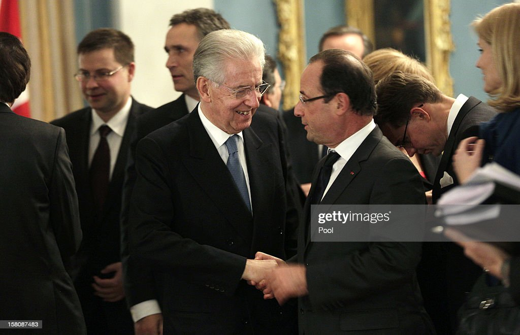 Italian Prime Minister Mario Monti (C) shakes hands with French President Francois Hollande after a working luncheon at the Gamle Logen hosted by Norway's Prime Minister for the EU leaders while they attend the Nobel Peace Prize Award Ceremony at Oslo City Hall on December 10, 2012 in Oslo, Norway. The European Union is collecting this year's prestigious Nobel Peace Prize for uniting the continent after two World Wars especially while during economic crisis.