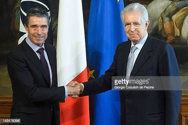 Italian Prime Minister Mario Monti shakes hands with NATO Secretary General Anders Fogh Rasmussen after a press conference at Palazzo Chigi on April...