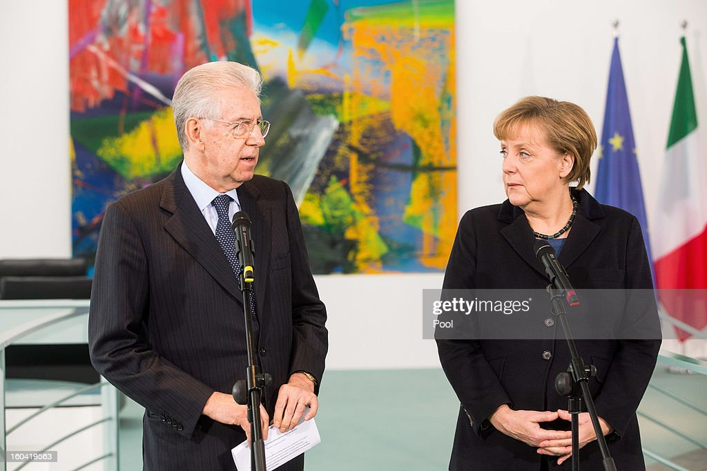 Italian Prime Minister <a gi-track='captionPersonalityLinkClicked' href=/galleries/search?phrase=Mario+Monti&family=editorial&specificpeople=632091 ng-click='$event.stopPropagation()'>Mario Monti</a> speaks beside <a gi-track='captionPersonalityLinkClicked' href=/galleries/search?phrase=Angela+Merkel&family=editorial&specificpeople=202161 ng-click='$event.stopPropagation()'>Angela Merkel</a> during a press conference before their meeting at the Chancellery on January 31, 2013 in Berlin, Germany. The German Chancellor is meeting with Italian Prime Minister <a gi-track='captionPersonalityLinkClicked' href=/galleries/search?phrase=Mario+Monti&family=editorial&specificpeople=632091 ng-click='$event.stopPropagation()'>Mario Monti</a> and Spanish Prime Minister Mariano Rajoy in Berlin to hold EU budget talks in preparation for the EU Summit to be held in Brussels next week.