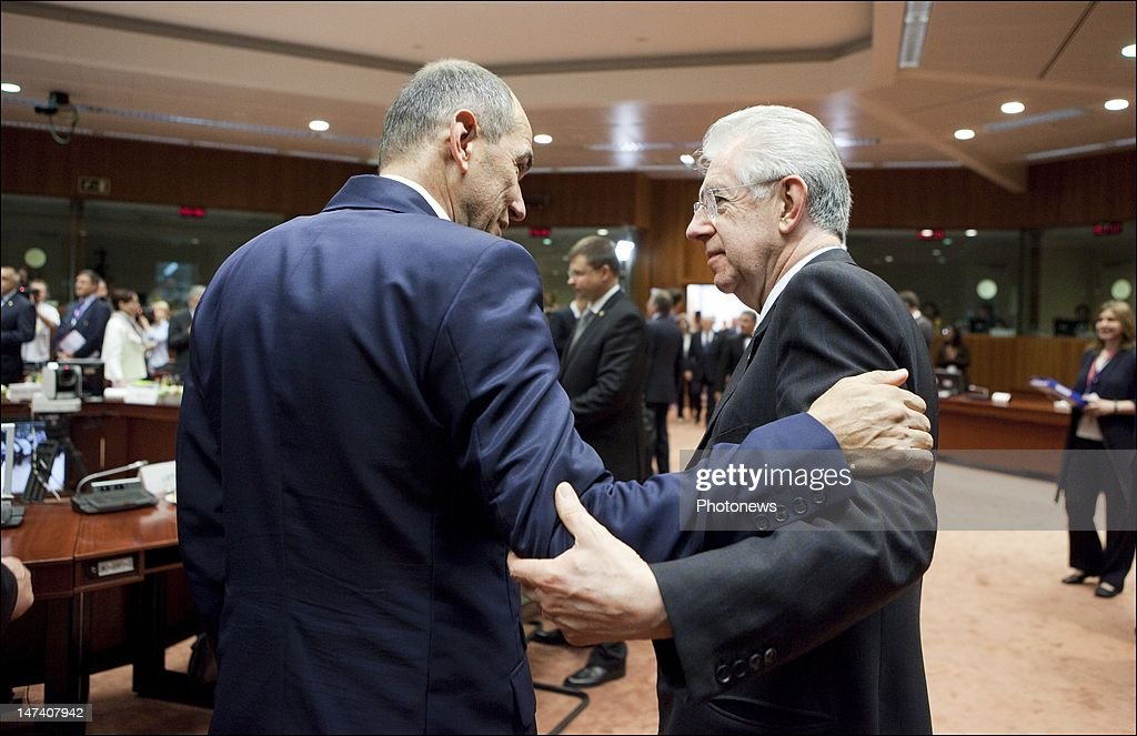 Italian Prime Minister <a gi-track='captionPersonalityLinkClicked' href=/galleries/search?phrase=Mario+Monti&family=editorial&specificpeople=632091 ng-click='$event.stopPropagation()'>Mario Monti</a> (R) speaks to Slovenian Prime Minister <a gi-track='captionPersonalityLinkClicked' href=/galleries/search?phrase=Janez+Jansa&family=editorial&specificpeople=566150 ng-click='$event.stopPropagation()'>Janez Jansa</a> on the second day of the European Summit on June 29, 2012 in Brussels, Belgium. Leaders are meeting to discuss the Multiannual Financial Framework, the European Semester and the European growth agenda.